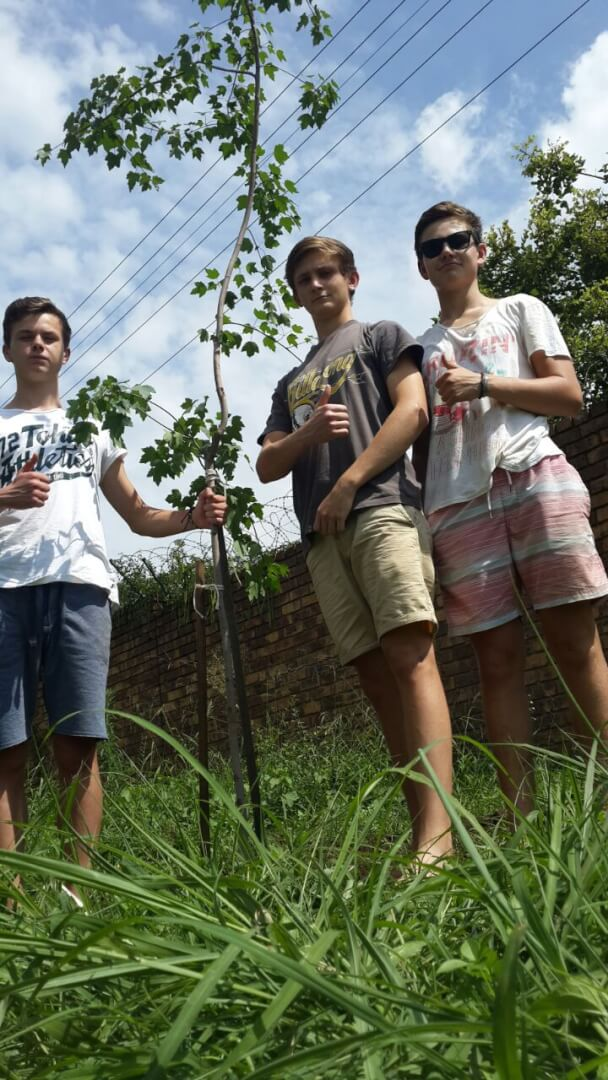 Chris Minnaar (Janette's son) and friends taking the initiative to plant trees for a greener environment.